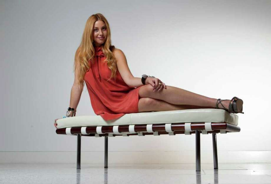 Whitney Port wears a Whitney Eve silk dress, $195, and Jimmy Choo diamante embellished heels $2,095. Miriam Salat cuffs, bangles and earrings; Belargo ring. All from Tootsies. Photo: James Nielsen, Staff / © 2011 Houston Chronicle