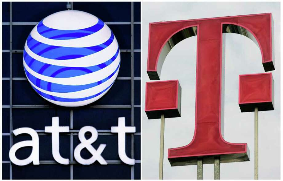 This file combination photo displays logos for AT&T, left, and Deutsche Telekom AG. The Justice Department filed suit Aug. 31, 2011, to block AT&T's $39 billion deal to buy T-Mobile USA on grounds that it would raise prices for consumers. Photo: Seth Perlman/Roberto Pfeil