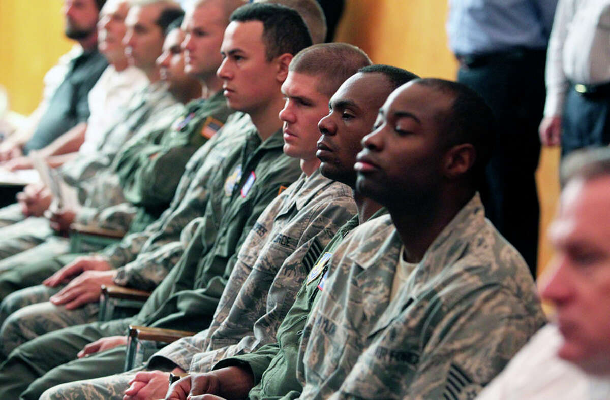 Airmen listen to the proceedings during the inactivation ceremony for the 311th Air Base Group at Brooks City Base on Wednesday, Aug. 31, 2011. Only a dozen or so people will remain at Brooks till Sept. 15.