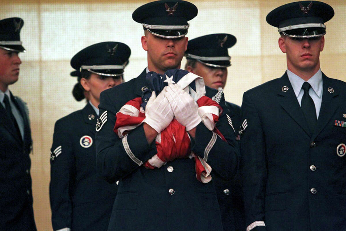Members of an Air Force honor guard bring in the flag for folding during the inactivation ceremony for the 311th Air Base Group at Brooks City-Base on Wednesday, Aug. 31, 2011.