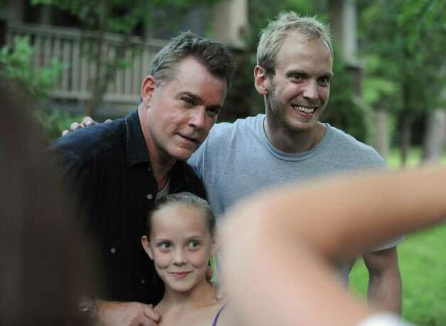 "Actor Ray Liotta takes a break from filming on set of the movie ""The Place Beyond the Pines"" to greet some eager fans waiting on Story Avenue in Niskayuna, N.Y. on Wednesday, Aug. 31, 2011.  Here, neighbors Laura Sitterly and Todd Krokowski get their photo taken with the actor. (Lori Van Buren / Times Union archive archive) Photo: Lori Van Buren"