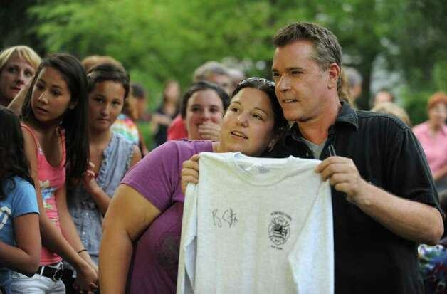 "Actor Ray Liotta takes a break from filming on set of the movie ""The Place Beyond the Pines"" to greet some eager fans waiting on Story Avenue in Niskayuna, N.Y., on Wednesday, Aug. 31, 2011.  Here Christine Helstowski gets her photo taken with the actor after having him sign a Schenectady Fire Department shirt.  (Lori Van Buren / Times Union archive) Photo: Lori Van Buren"