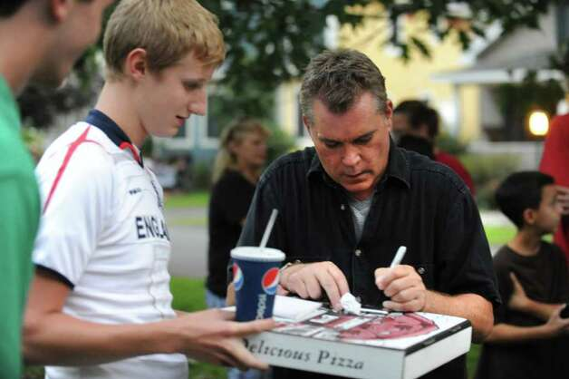 "Actor Ray Liotta takes a break from filming on set of the movie ""The Place Beyond the Pines"" to greet some eager fans waiting on Story Avenue in Niskayuna, N.Y. on Wednesday, Aug. 31, 2011. Here Ted Dalakos has the actor sign an autograph as he comes home from picking up a pizza.  (Lori Van Buren / Times Union archive) Photo: Lori Van Buren"