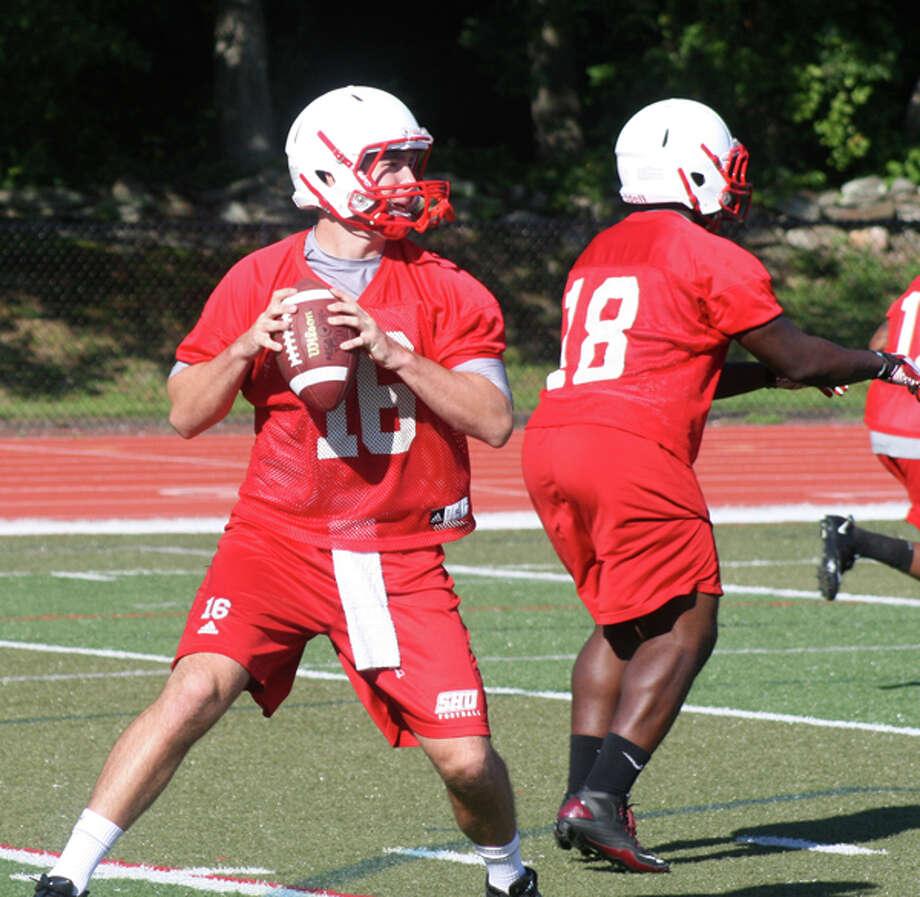 Sacred Heart redshirt sophomore quarterback Tim Little drops back during practice, August 2011.