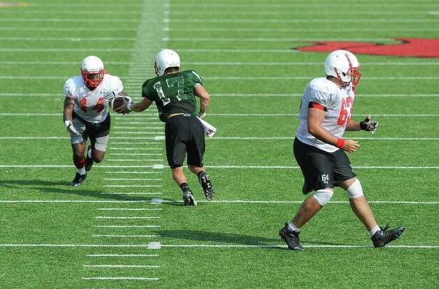Center Kyle Gillam, quarterback Doug Prewitt and running back DePauldrick Garrett execute Lamar's new pistol play that is hoped to improve the teams running game. Guiseppe Barranco/The Enterprise Photo: Guiseppe Barranco