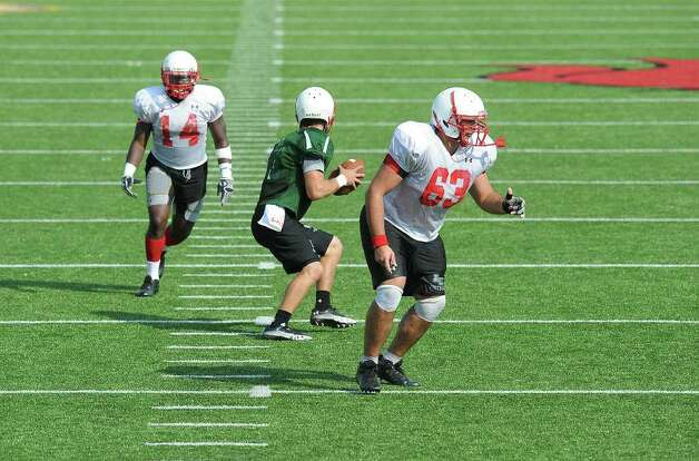 Center Kyle Gillam, quarterback Doug Prewitt and running back DePauldrick Garrett execute Lamar's new pistol play that is hoped to improve the teams running game. Guiseppe Barranco/The Enterprise