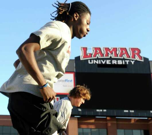 Former Silsbee quarterback, Jeremy Johnson works out during a team workout at Lamar University in Beaumont, Wednesday. Johnson recently transfered Tammy McKinley/The Enterprise Photo: TAMMY MCKINLEY / Beaumont