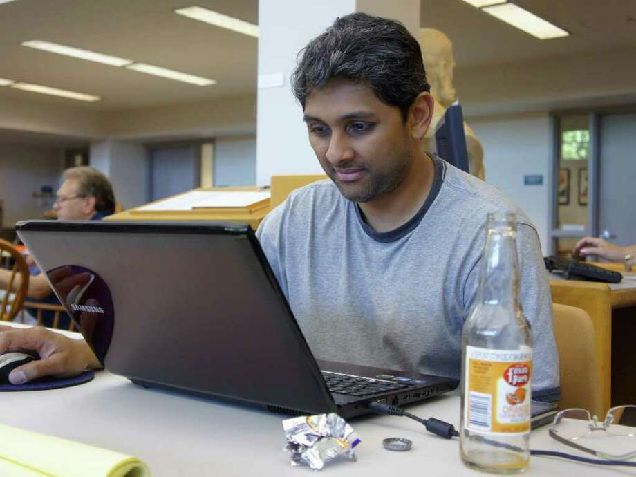 Sam Somashekar works on his laptop at the Westport Public Library on Tuesday, Aug. 30, 2011. Photo: Paul Schott / Westport News
