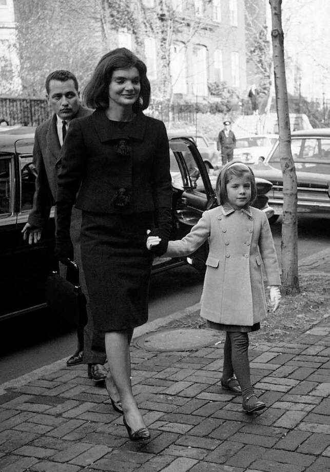 FILE - In this Dec. 6, 1963 file photo, Jacqueline Kennedy and her daughter, six-year-old Caroline, arrive at their new home in the Georgetown section of Washington two weeks after her husband was slain in Dallas, Texas. An ABC special with never-before-heard interviews with Jacqueline Kennedy will air Sept. 13. Viewers will hear the former first lady speak with historian Arthur Schlesinger Jr. about life in the White House and with her husband, President John F. Kennedy. The recordings were made months after the president's 1963 assassination and sealed until now. (AP Photo/Bob Schutz, file) Photo: Bob Schutz, STF / 1963 AP
