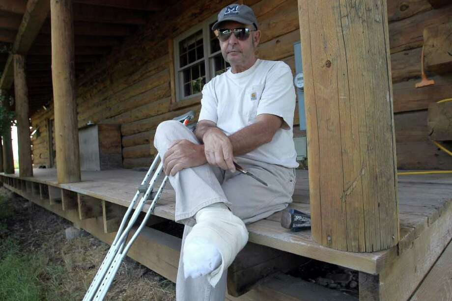In this Tuesday, Aug. 30, 2011 photo, John Hutt holds his Old Timer pocketknife while sitting on the front porch of his home in Montrose, Colo. On Aug. 19, 2011, Hutt became pinned on his logging truck and was forced to cut off his own toes to get to safety. (AP Photo/The Grand Junction Daily Sentinel, William Woody) Photo: William Woody, MBR / The Grand Junction Daily Sentine