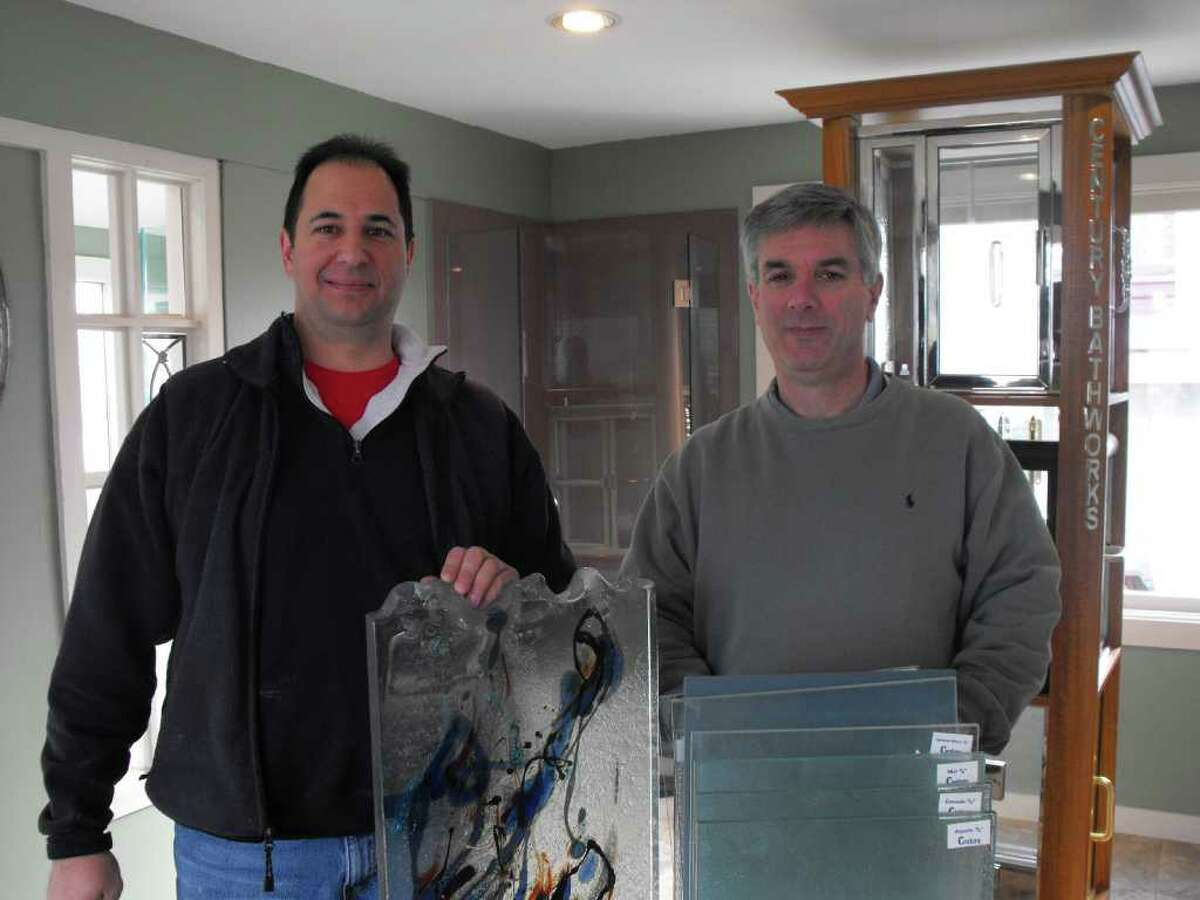 Rob Sassone, left, and John Petchonka are the co-owners of Ridgefield Glass in Danbury.