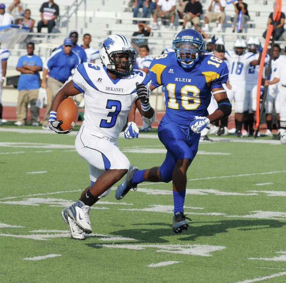 Dekaney junior running back Trey Williams (3) and Klein senior defensive back Eric Rowe (18) during a 17-13 Klein victory against Dekaney on 10-23-10 at Klein Memorial Stadium. Photo: L. Scott Hainline / freelance