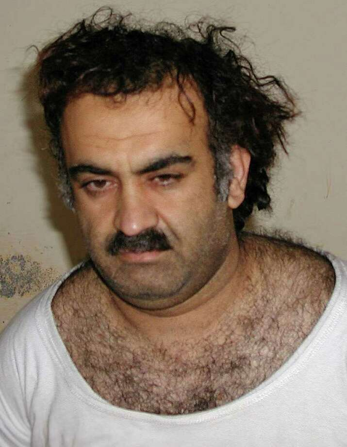 In this March 1, 2003 file picture, Khalid Sheikh Mohammed is seen shortly after his capture during a raid in Pakistan. A hidden network of American companies headed by a prominent defense contractor played a central role in the CIA's secret post-9/11 airlift that whisked captured terror suspects and their American minders to overseas prisons, according to testimony and documents filed in an upstate New York court case.  (AP Photo/File)