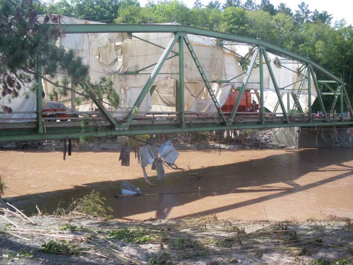 The bridge over the Schoharie Creek in Prattsville, N.Y. DOT crews from as far away as Saratoga County have been on-scene since Monday morning. (Jimmy Vielkind / Times Union)