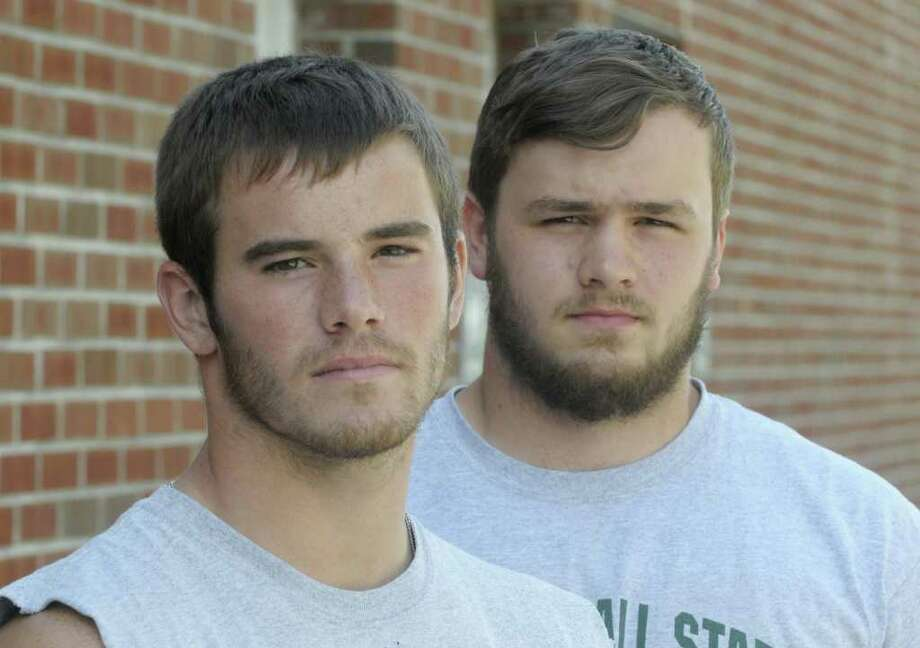 Averill Park High School football players Joe Marino, left, and Axel Bryce, pose for a photograph onTuesday, Aug. 30, 2011 in Averill Park.  (Paul Buckowski / Times Union) Photo: Paul Buckowski  / 00014446A