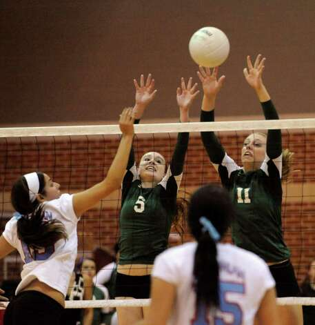 Sarah Taylor (5) and Erin Holscher (11) of Incarnate Word High defend during girls prep volleyball action against Antonian on Wednesday, Aug. 31, 2011. BILLY CALZADA / gcalzada@express-news.net  Antonian at Incarnate Word volleyball Photo: BILLY CALZADA, Express-News / gcalzada@express-news.net
