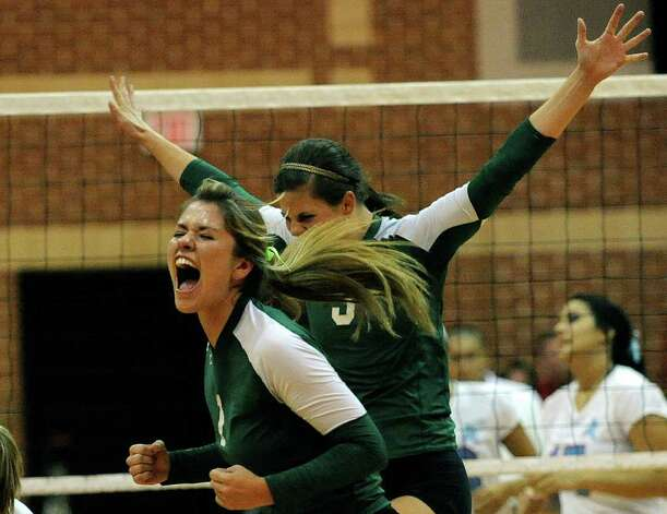 Kimberley Vaio and Kailey Manka of Incarnate Word High School celebrate after scoring a point against Antonian during girls prep volleyball action on Wednesday, Aug. 31, 2011. BILLY CALZADA / gcalzada@express-news.net Photo: BILLY CALZADA, Express-News / gcalzada@express-news.net