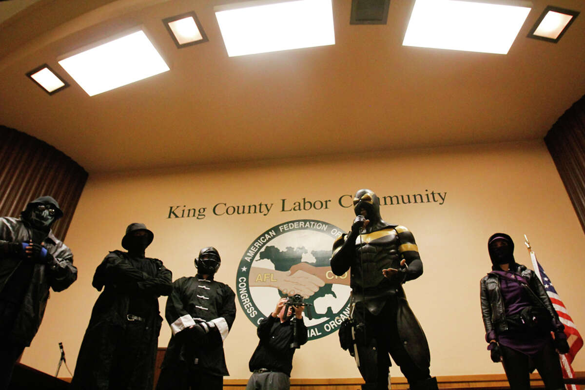 Phoenix Jones and his crew speak on safety and hand out pepper spray at the Belltown Community Safety Meeting at the Labor Temple in Seattle Washington on Wednesday, Aug. 31, 2011.