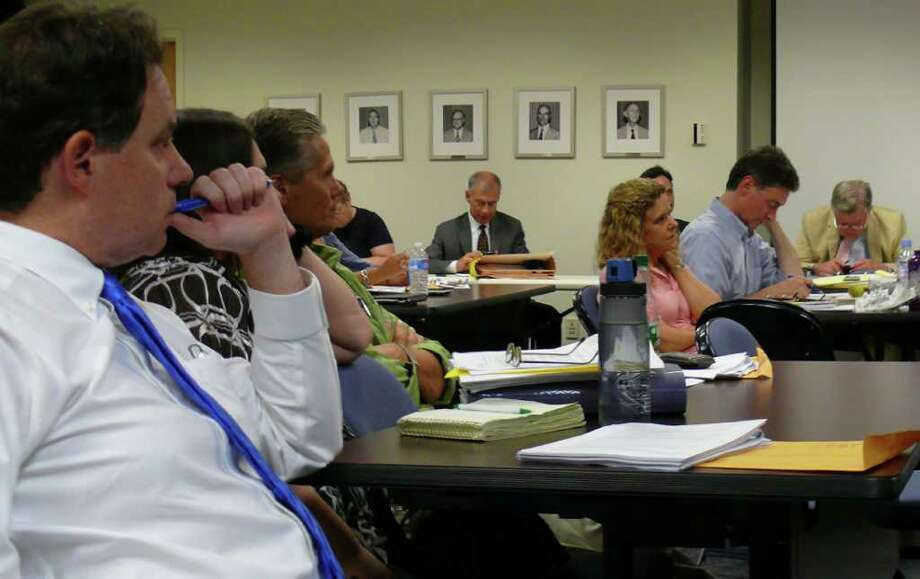 Members of the Fairfield Representative Town Meeting deliberate Wednesday night on the proposal to issue bonds for an additional $7.5 million to complete the Fairfield Metro railroad station. Photo: Genevieve Reilly / Fairfield Citizen