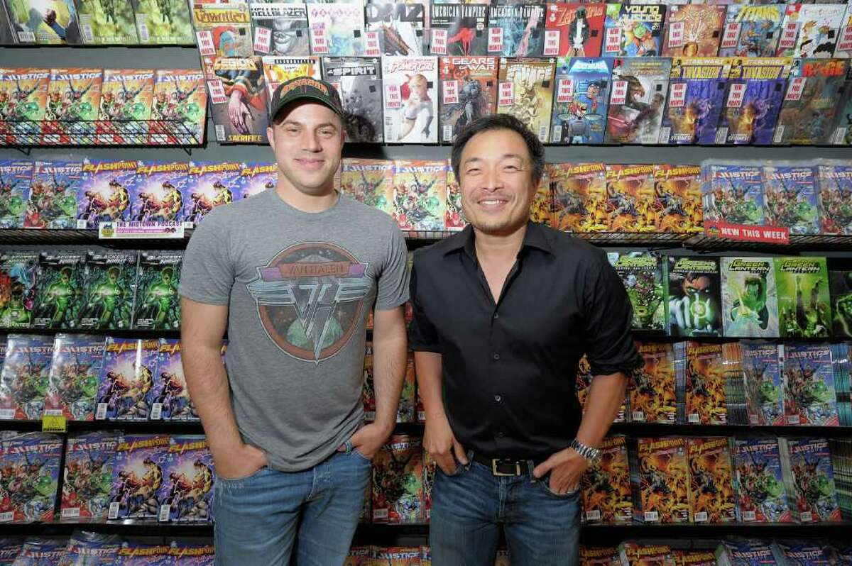 NEW YORK, NY - AUGUST 30: Jim Lee, artist and co-publisher of DC Comics and Geoff Johns, DC Comics co-publisher at Midnight Madness event celebrating the release of New No. 1 issue of 'Justice League' at Mid Town Comics on August 30, 2011 in New York City.