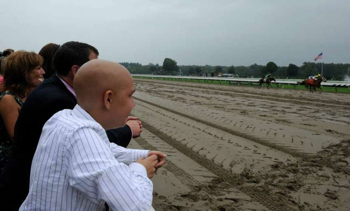 Luke Romano watches a race named for him at the Saratoga Race Course in Saratoga Springs on Aug. 16, 2010. (Skip Dickstein/Times Union archive)