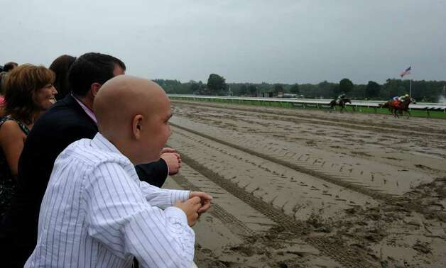 Luke Romano watches a race named for him at the Saratoga Race Course in Saratoga Springs on Aug. 16, 2010.  (Skip Dickstein/Times Union archive) Photo: Skip Dickstein