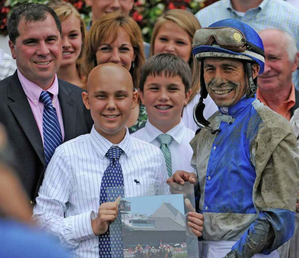 Luke Romano in the winners circle after a race named for him at the Saratoga Race Course in Saratoga Springs on Aug. 16, 2010. (Skip Dickstein/Times Union archive)