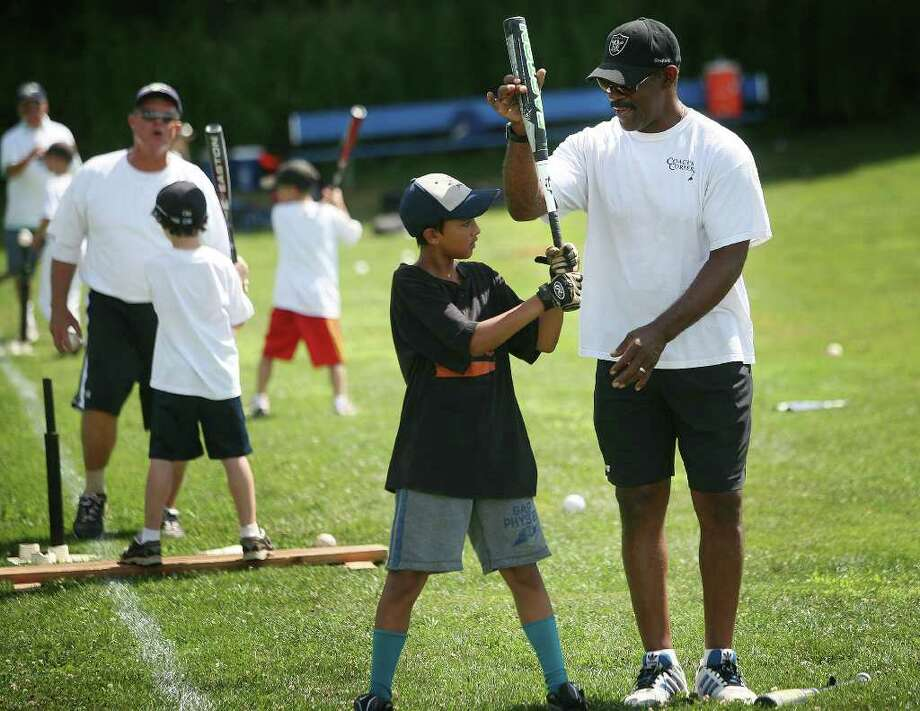 Thomas Samaranayake, 10 of Norwalk, gets hitting tips from Bluefish manager and former major leaguer Willie Upshaw at Baseball World camp at Wakeman Field in Westport on Wednesday, July 27, 2011. Photo: Brian A. Pounds / Connecticut Post