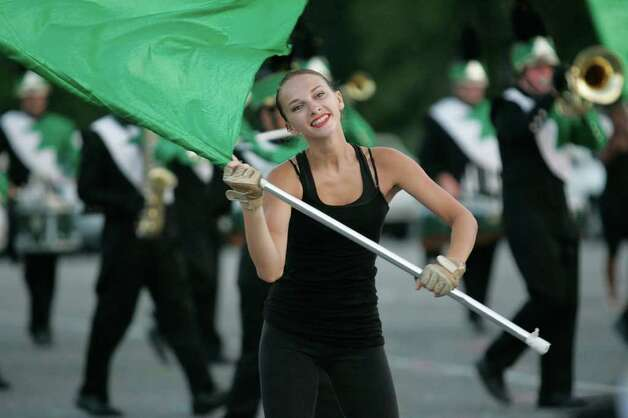 "Mallory Papp, a junior at Norwalk High School, performs with members of the Norwalk HS Color Guard during ""Spirit NIght"" at Andrews Field in Norwalk on Friday evening.  © J. Gregory Raymond Photo: J. Gregory Raymond / Stamford Advocate Freelance"