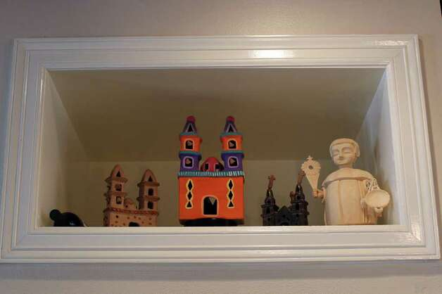 A high nook in the kitchen displays church figures collected on the couple's travels to Mexico. Photo: Jennifer Whitney, Special To The Express-News / special to the Express-News