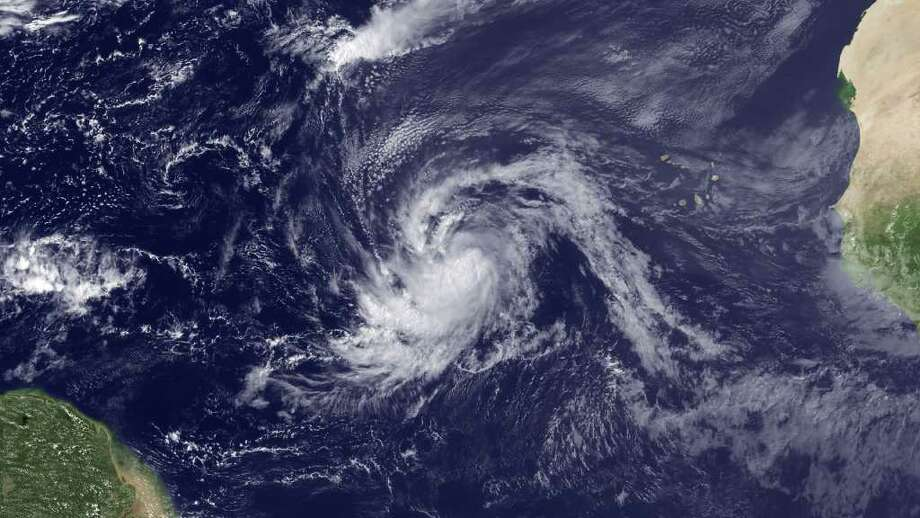 This satellite image provided by NOAA and taken Tuesday, Aug. 30, 2011, shows Tropical Storm Katia. Hurricane Katia is continuing its trek across the Atlantic Thursday, Sept. 1, 2011, with little change in strength.  The U.S. National Hurricane Center in Miami says some strengthening is expected and Katia could become a major hurricane by the weekend.(AP Photo/NOAA) Photo: Anonymous, HOPD / NOAA