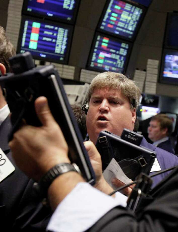 FILE - In this Aug. 16, 2011 file photo, traders work on the floor of the New York Stock Exchange. European stocks failed to keep up with gains in Asia on Thursday, Sept. 1, 2011, as downbeat reports on the manufacturing sector darkened investors' moods. (AP Photo/Richard Drew, File) Photo: Richard Drew, STF / AP
