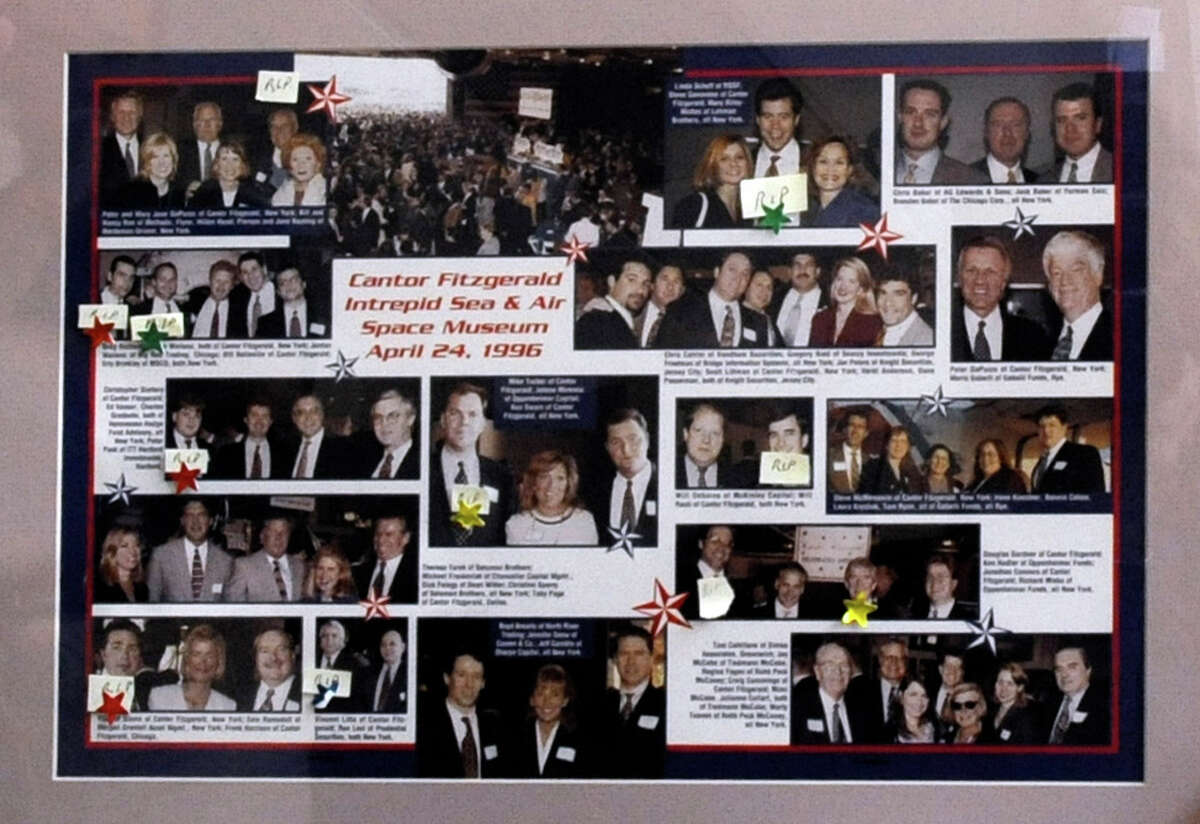 A photo from an April 1996 Cantor Fitzgerald company party at the Intrepid Sea, Air and Space Museum in New York City shows the former colleagues of Peter DaPuzzo, former head of the company's institutional equities division. Of the 11 colleagues in the photo who worked at the World Trade Center, only DaPuzzo, a Riverside resident, did not die in the Sept. 11 terrorist attacks.