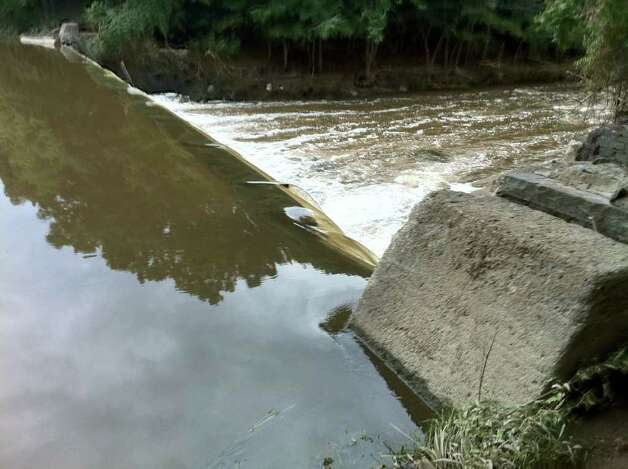 This portion of the Poesten Kill Dam in Troy was damaged. (KENNETH C. CROWE II / TIMES UNION)