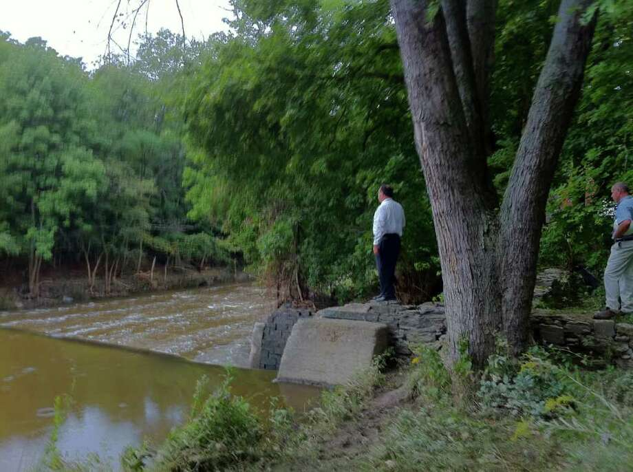 Troy Mayor Harry Tutunjian takes a look at the Poesten Kill Dam which shifted on Thursday, triggering fear it could burst. (KENNETH C. CROWE II / TIMES UNION)