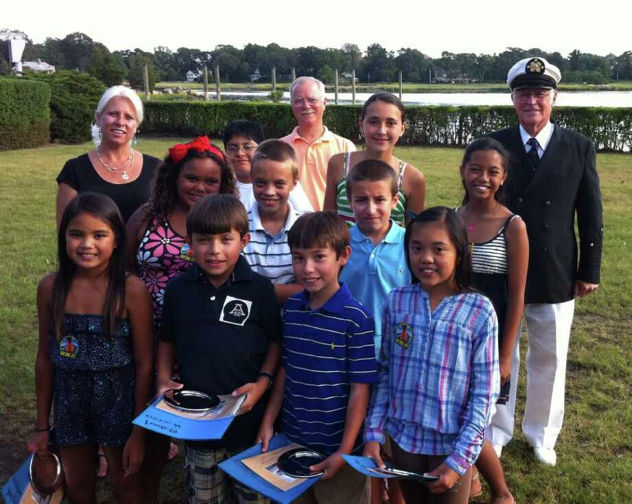 Ten students in the Young Mariners Foundation of Greenwich pose after graduating from a sailing program Wednesday at Riverside Yacht Club. Pictured, front rwo from left: Alyzah Rumbada, Michael Rincon, Marvin Campos and Mia Binuya. Second row from left: Angelique Keys, Kevin Wing, Kyle Kelly and Bianca Petate. Third row from left: Diego Sanchez and Sophia Daoud. Back row from left: Dawn Berrocal, Boys & Girls Club of Greenwich aquatic director; Tom O'Connell, founder of the Greenwich foundation; and Riverside Yacht Club Commodore Walton Alder. Photo: Frank MacEachern