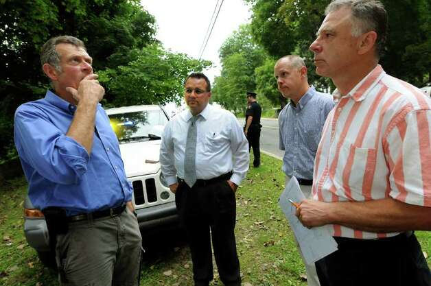 City engineer Russ Reeves, left, talks about repairing the compromised Poesten Kill Dam on Thursday, Sept. 1, 2011, in Troy, N.Y. Joining him are Mayor Harry Tutunjian, center, and CDM Engineering's project manager Greg Bold, second from right, and Bill Friers senior civil engineer of CDM Engineering. (Cindy Schultz / Times Union) Photo: Cindy Schultz