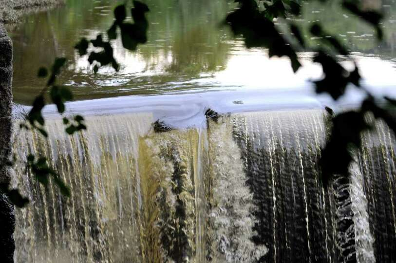 The raised flap, center, of the Poesten Kill Dam is the area of concern on Thursday, Sept. 1, 2011,