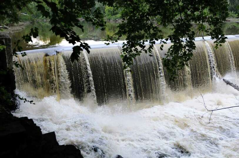 The raised flap, left, of the Poesten Kill Dam is the area of concern on Thursday, Sept. 1, 2011, in