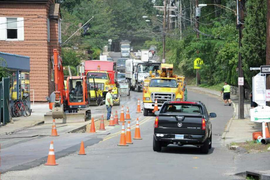 Workers repair water infrastructure on Riversville Road in Glenville near the site of two recent water main breaks at the intersection of Riversville Road and Glenville Road, Thursday, Sept. 1, 2011. Photo: Bob Luckey / Greenwich Time