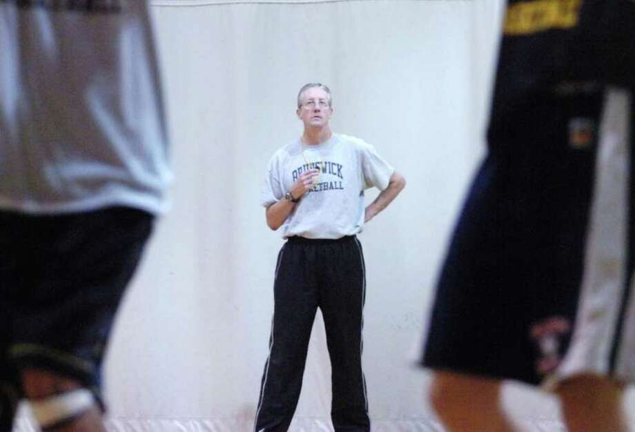 Brunswick basketball coach Greg Dobbs conducts practice in December of 2009. Dobbs who coach Brunswick to multiple FAA championships, will be the coach at rival King School this winter. Photo: Keelin Daly