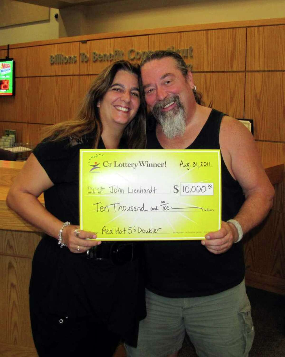 John ìRickî Leinhardt and Joan Brown of Cos Cob pose with the check they won in a Connecticut Lottery scratch ticket game on Monday, August 29, 2011.
