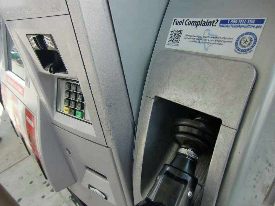 New gas pump sticker added to gasoline pumps that directs motorists to a mobile phone website providing station inspection information and a form to complain if they believe a pump is inaccurate. Simone Sebastian : Houston Chronicle Photo: Simone Sebastian