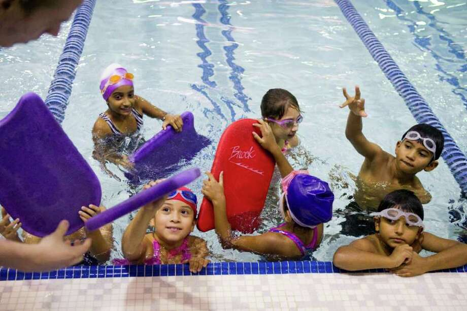 More than 50 kids take advantage of a stroke clinic preparing swimmers for next week's Stamford Stingrays Swim Team tryouts at the YMCA in Stamford, Conn., September 1, 2011. This is the first club team at the Y which has finally grown enough of a program to form a team that will range in ages from 6-18 and feature multiple levels. Ali Alnouri, a former Westhill High swimmer and major player in the development of the YMCA swim team program, will coach the team. He also serves as an assistant coach at the University of Bridgeport and will bring college level athletes to the Y for demonstrations. Photo: Keelin Daly / Stamford Advocate