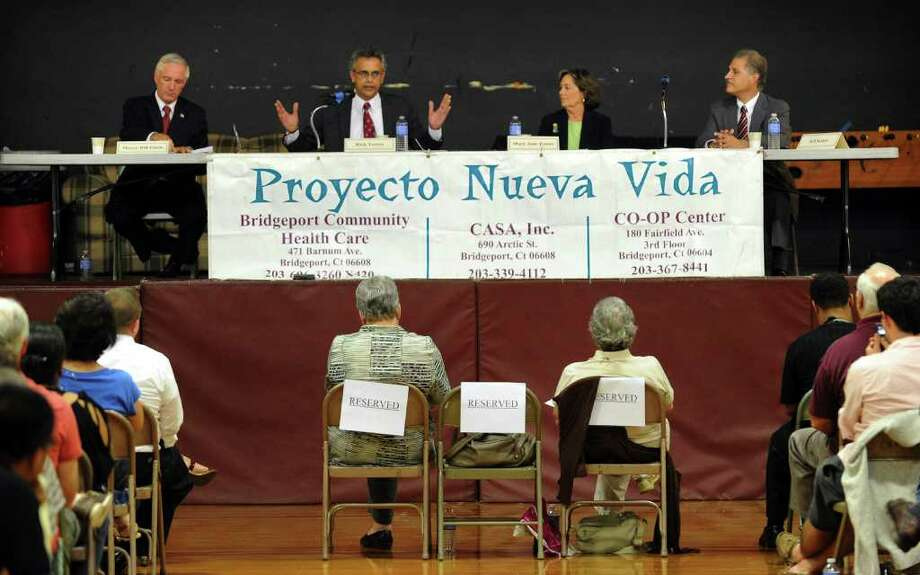 The League of Women Voters and Proyecto Nueva Vida, which is a coalition of three agencies: CASA, Optimum, and the Co-Op Center, held a mayoral debate at the McGiveney Center on Stillman Street in Bridgeport, Conn. on Thursday September 1, 2011. From left to right is Bridgeport Mayor Bill Finch, and candidates Rick Torres (R), Mary-Jane Foster (D), and Jeff Kohut (I). Photo: Christian Abraham / Connecticut Post