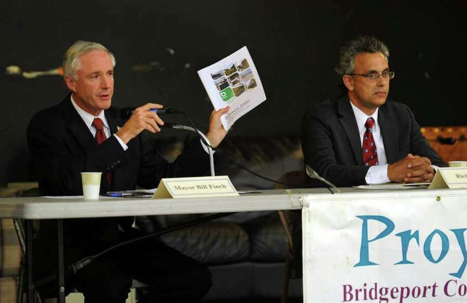 The League of Women Voters and Proyecto Nueva Vida, which is a coalition of three agencies: CASA, Optimum, and the Co-Op Center, held a mayoral debate at the McGiveney Center on Stillman Street in Bridgeport, Conn. on Thursday September 1, 2011. From left to right is Bridgeport Mayor Bill Finch, and Republican candidate Rick Torres. Photo: Christian Abraham / Connecticut Post