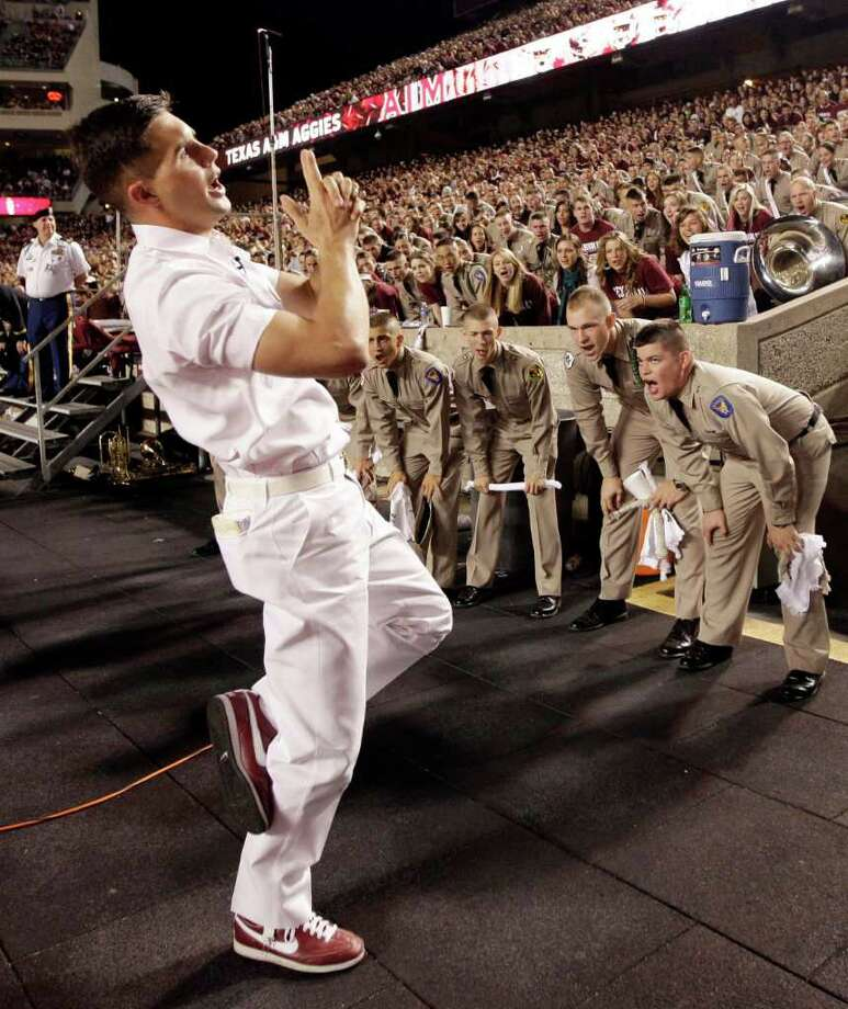 In this photo taken Nov. 20, 2010, a Texas A&M yell leader leads the crowd in a cheer before an NCAA college football game against Nebraska in College Station, Texas. Texas A&M dealt a blow to the Big 12 Conference on Wednesday, Aug. 31, 2011, saying it plans to leave by July 2012 if it is accepted by the SEC or another league. (AP Photo/David J. Phillip, File) Photo: David J. Phillip, STF / AP2010
