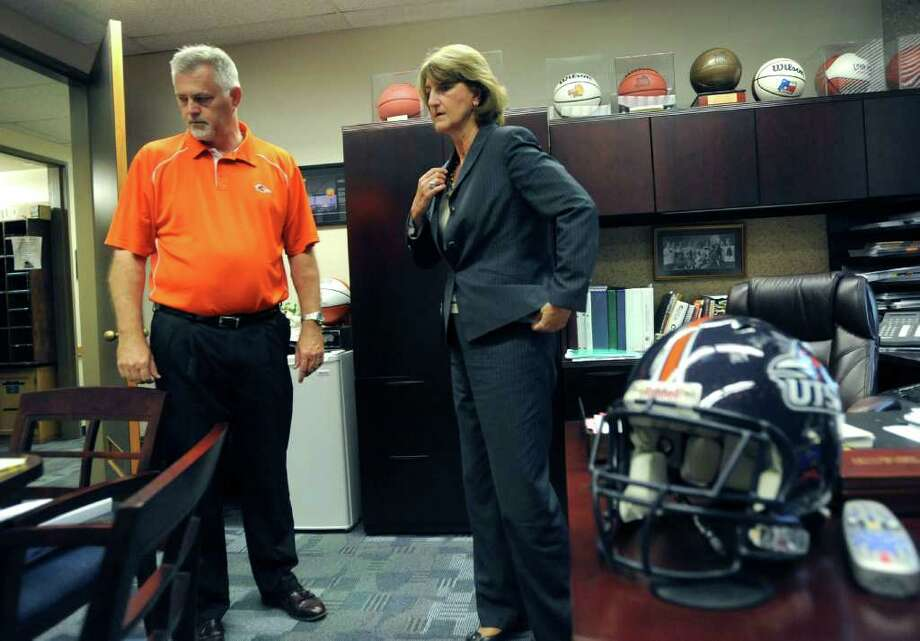 Lynn Hickey, UTSA director of athletics, right, speaks with Jim Goodman, associate athletics director, on Tuesday, Aug. 30, 2011. Hickey was instrumental in getting the university's football team started. BILLY CALZADA/gcalzada@express-news.net Photo: BILLY CALZADA, Express-News / gcalzada@express-news.net