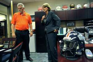 Lynn Hickey, UTSA director of athletics, right, speaks with Jim Goodman, associate athletics director, on Tuesday, Aug. 30, 2011. Hickey was instrumental in getting the university's football team started. BILLY CALZADA / gcalzada@express-news.net