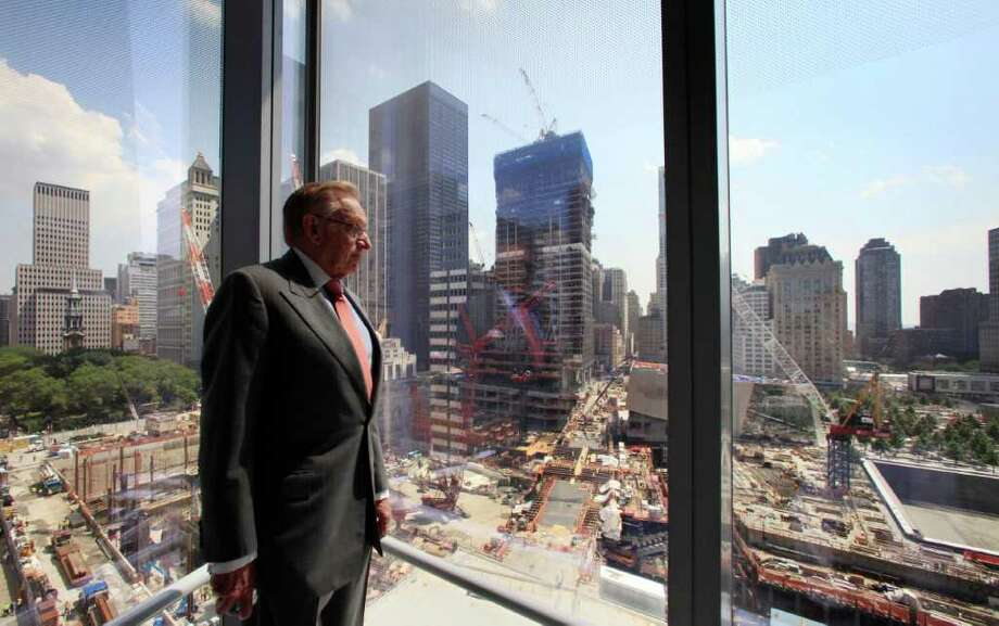In this July 19, 2011 photo, developer Larry Silverstein looks out from his office tower, 7 World Trade Center, at the ongoing construction of the World Trade Center site in New York. His company, Silverstein Properties, is constructing three office towers at the site that was ravaged in the attacks of Sept. 11, 2001. (AP Photo/Mark Lennihan) Photo: Mark Lennihan, AP / AP